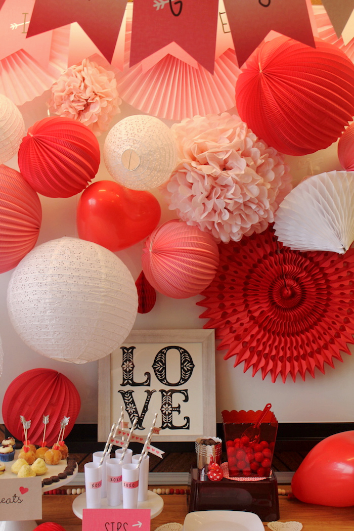 valentine's sweet table decorated with paper lanterns and pompoms
