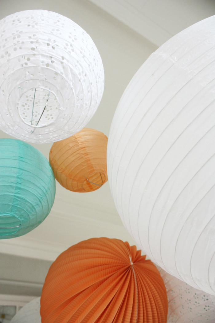 Beautiful wedding decoration in mint and peach, sky of lanterns and pompoms