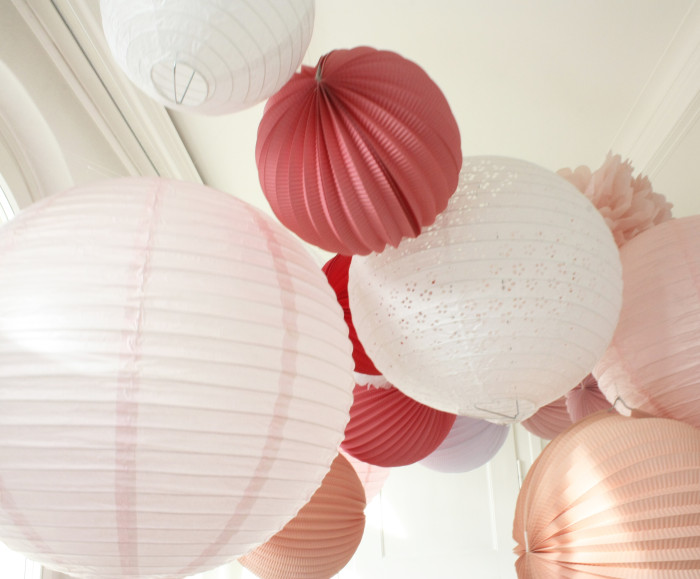 Wedding, baptism or garden party decor with a beautiful pink sky of lanterns