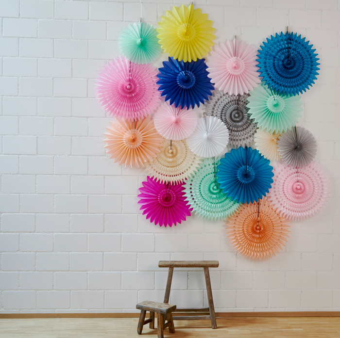 party backdrop with paper fans